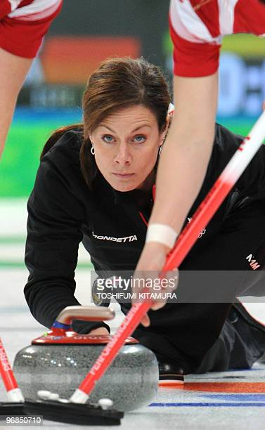 Canada's skip Cheryl Bernard throws the stone during their round robin match against Germany in the Vancouver Winter Olympic women's curling...