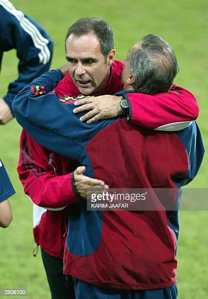 Canada's soccer coach Dale Mitchell hugs his Spanish counterpart Jose Ufarte after Spain defeated Canada 21 on a golden goal in the quarterfinals of...