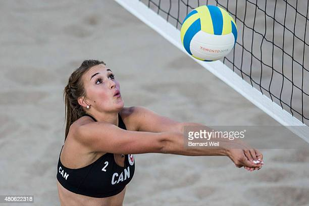 Canada's Taylor Pischke sets up a spike for teammate Melissa Humana-Parades in a Pan Am Games beach volleyball preliminary round against Cayman...