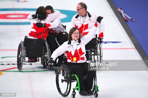 Canada's team celebrate their victory in the wheelchair curling bronze medal game between South Korea and Canada at the Gangneung Curling Centre...
