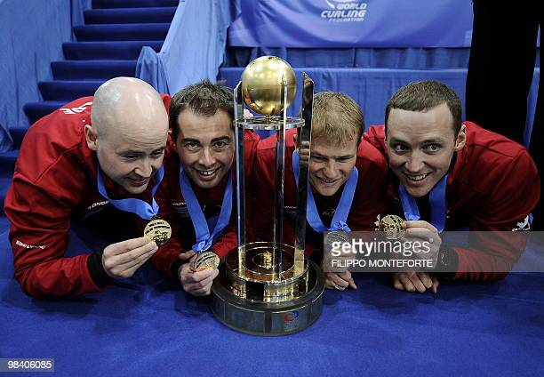 Canada's team celebrate with the trophy and medals after winning the Men's curling world championship on April 11 2010 in Cortina D'Ampezzo Canada...