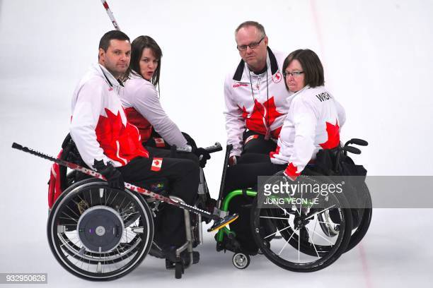 Canada's team talks in the wheelchair curling bronze medal game between South Korea and Canada at the Gangneung Curling Centre during the Pyeongchang...