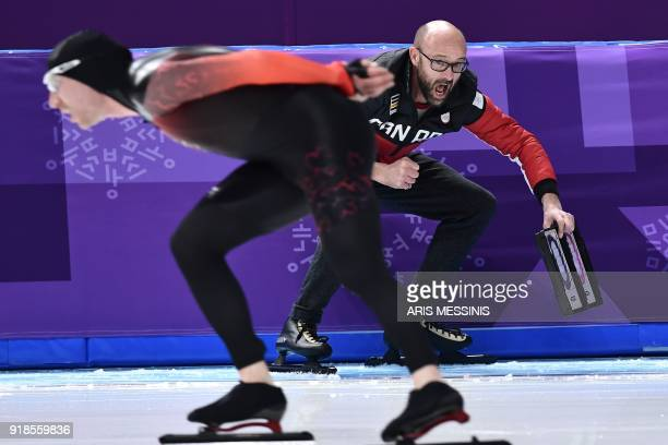 Canada's Ted-Jan Bloemen skates past his coach as he competes in the men's 10,000m speed skating event during the Pyeongchang 2018 Winter Olympic...