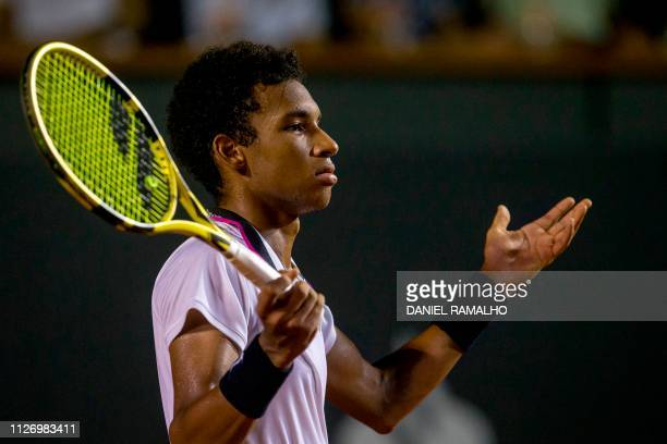 Canada's tennis player Felix AugerAliassime reacts during the ATP World Tour Rio Open singles semifinal match against Uruguay's Pablo Cuevas at the...