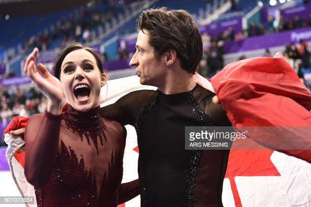 Canada's Tessa Virtue and Canada's Scott Moir celebrate following the venue ceremony after the ice dance free dance of the figure skating event...