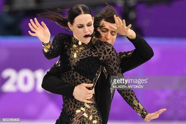 TOPSHOT Canada's Tessa Virtue and Canada's Scott Moir compete in the ice dance short dance of the figure skating event during the Pyeongchang 2018...