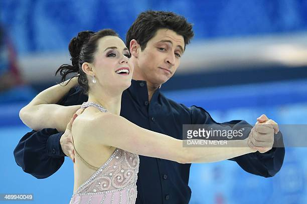 Canada's Tessa Virtue and Canada's Scott Moir perform in the Figure Skating Ice Dance Free Dance at the Iceberg Skating Palace during the Sochi...