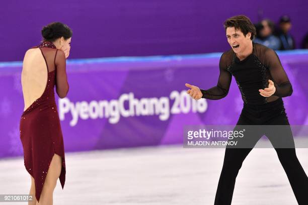 Canada's Tessa Virtue and Canada's Scott Moir react after competing in the ice dance free dance of the figure skating event during the Pyeongchang...