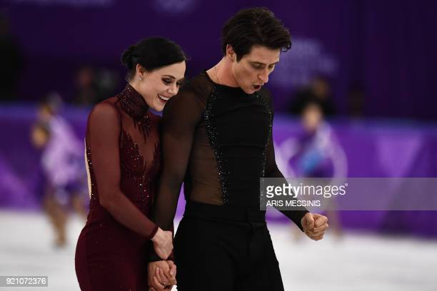 TOPSHOT Canada's Tessa Virtue and Canada's Scott Moir react after competing in the ice dance free dance of the figure skating event during the...