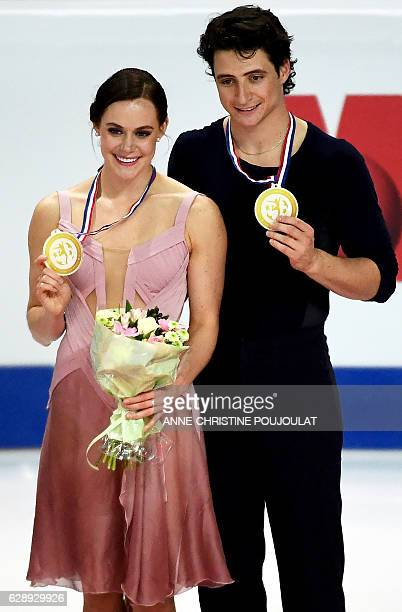 Canada's Tessa Virtue and Scott Moir pose on the podium with their gold medals as they celebrate after winning the Senior Ice Dance free program at...