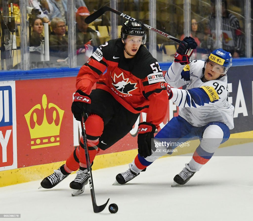 Canada s Thomas Chabot challenges for the puck with Korea s Shin ... 50cdeacb1