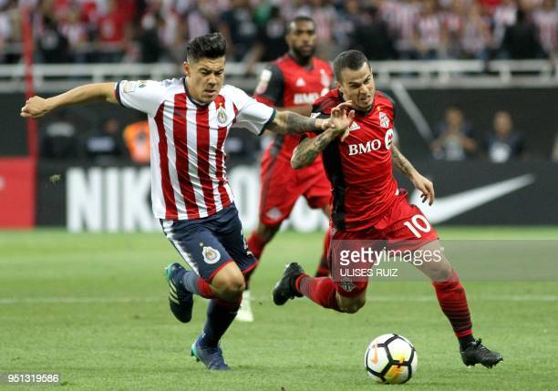 Canada's Toronto FC forward Sebastian Giovinco vies for the ball with Mexico's Guadalajara midfielder Michael Perez during their Concacaf Champions...