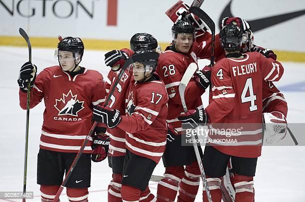 Canada's Travis Dermott Travis Konecny Lawson Crouse and Haydn Fleury celebrate after winning the 2016 IIHF World Junior U20 Ice Hockey Championships...
