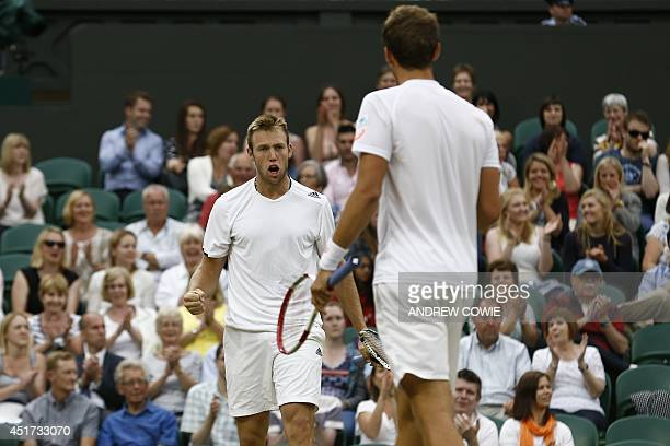 Canada's Vasek Pospisil and Jack Sock react to winning a point against US players Bob and Mike Bryan during their men's doubles final match on day...