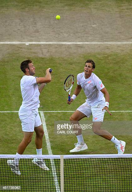 Canada's Vasek Pospisil and US player Jack Sock play a shot against US players Bob and Mike Bryan during their men's doubles final match on day...