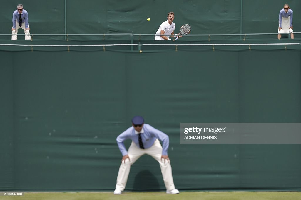 TOPSHOT - Canada's Vasek Pospisil (top) returns against Spain's Albert Ramos-Vinolas during their men's singles first round match on the second day of the 2016 Wimbledon Championships at The All England Lawn Tennis Club in Wimbledon, southwest London, on June 28, 2016. / AFP / ADRIAN