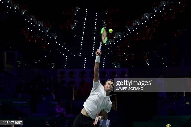 Canada's Vasek Pospisil serves to Russia's Andrey Rublev during the semifinal singles tennis match between Russia and Canada at the Davis Cup Madrid...