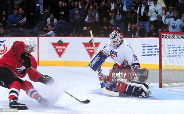 Canada's Vincent Damphousse moves in close with puck against USA goaltender Mike Richter. Richter won the battle and the MVP as well in the 1996...