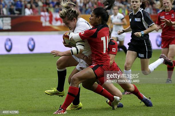 Canada's wing Magali Harvey tackles England's flanker Marlie Packer during the IRB Women's Rugby World Cup final match between England and Canada at...