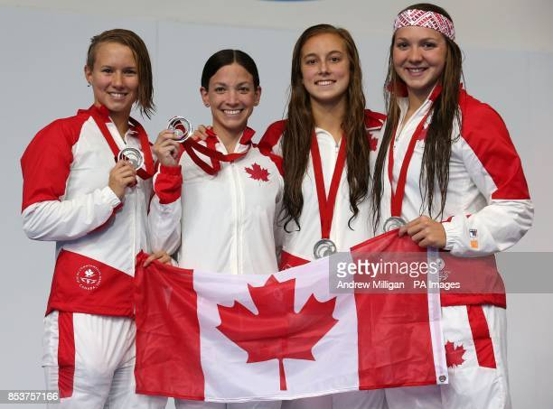 Canada's Women Samantha Cheverton Brittany MacLean Alyson Ackman and Emily Overholt with their Silver medals after coming second in the 4x200m...