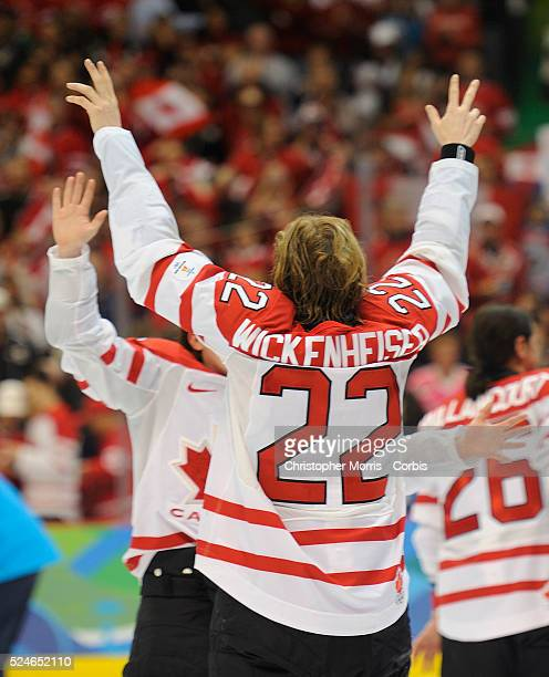 Canada's women's hockey team captain Haley Wickenheiser celebrates after beating the United States to win the gold medal in hockey at Canada Hockey...