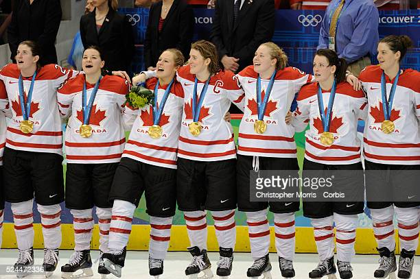 Canada's women's hockey team members celebrate after beating the United States 20 to win the gold medal in hockey at Canada Hockey Place day 14 of...