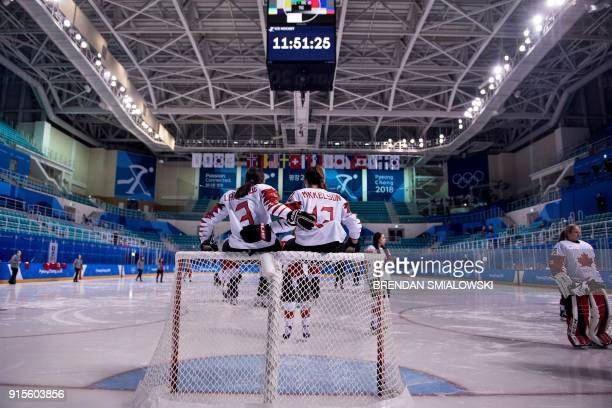 Canada's women's ice hockey teammates Jocelyne Larocque and Meaghan Mikkelson pose for a photo during a practice at the Kwandong Hockey Centre before...