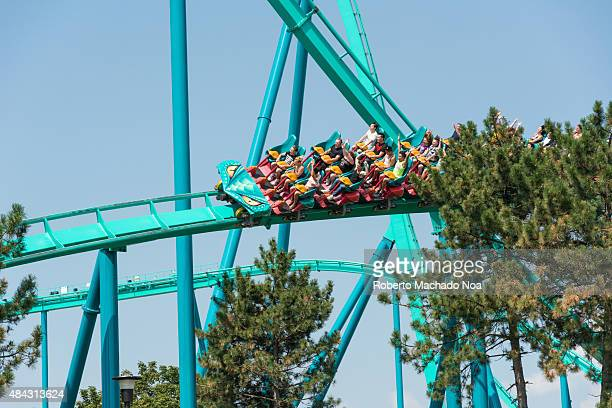 Canada's Wonderland Leviathan Roller CoasterColorful looping roller coaster on a beautiful sunny day A red roller coaster where passengers lie in the...