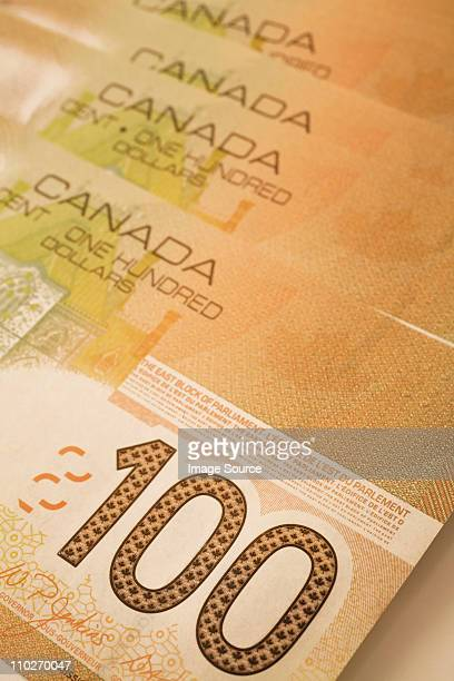 canadian 100 dollar banknotes - canadian one hundred dollar bill stock pictures, royalty-free photos & images