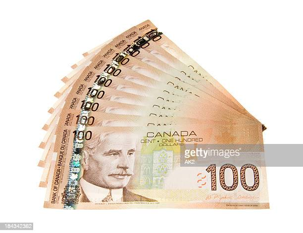 canadian 100 dollar bills - canadian one hundred dollar bill stock pictures, royalty-free photos & images