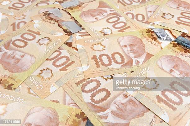 canadian 100 hundred dollar bills - canadian one hundred dollar bill stock pictures, royalty-free photos & images
