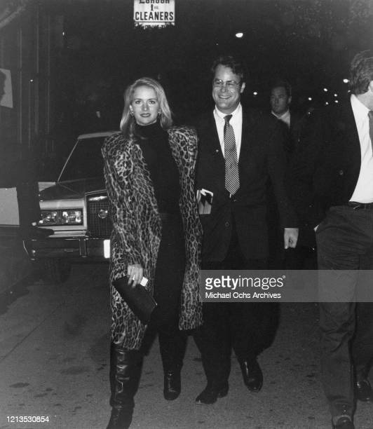 Canadian actor and comedian Dan Aykroyd and his wife, actress Donna Dixon arrive at the opening of the film 'Empire of the Sun' in Los Angeles,...