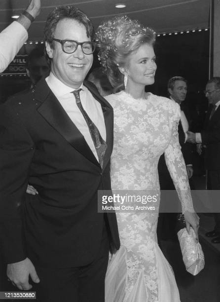 Canadian actor and comedian Dan Aykroyd and his wife, actress Donna Dixon arrive at the opening of the film 'Spies Like Us' in New York City, 1985....