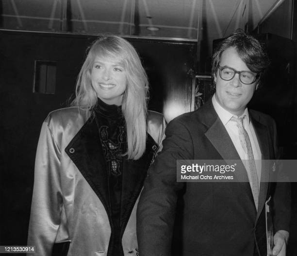 Canadian actor and comedian Dan Aykroyd and his wife, actress Donna Dixon at a party for fellow 'Saturday Night Live' alumnus Eddie Murphy in Los...
