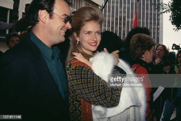Canadian actor and comedian Dan Aykroyd and his wife American actress Donna Dixon with their daughter Danielle Aykroyd attend the premiere of 'Hook'...