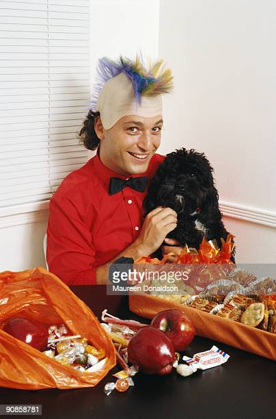 Canadian actor and comedian Howie Mandel with a haul of Halloween candy circa 1985