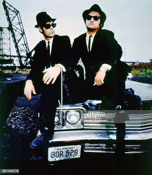 Canadian actor and screenwriter Dan Aykroyd and American actor John Belushi on the set of The Blues Brothers directed by John Landis