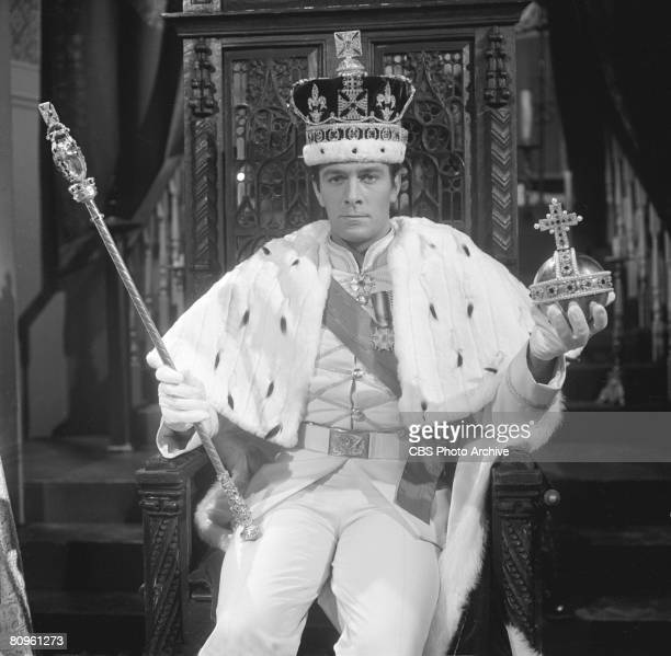 Canadian actor Christopher Plummer dressed in kingly attire with a bejewelled scepter and orb in his hands in a scene from 'The DuPont Show of the...