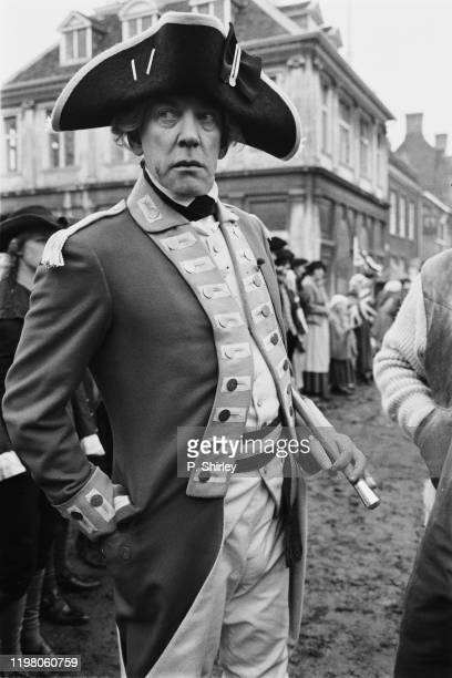 Canadian actor Donald Sutherland in period costume as 'Sgt Maj Peasy' during the filming of historical drama film 'Revolution' UK 25th March 1985
