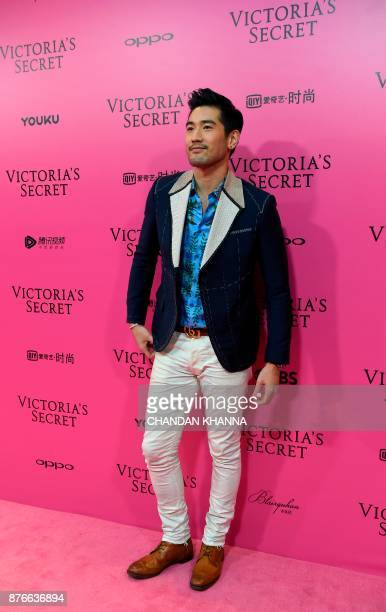 Canadian actor Godfrey Gao aka Godfrey Tsao poses on the Pink Carpet ahead of the start of the 2017 Victoria's Secret Fashion Show in Shanghai on...