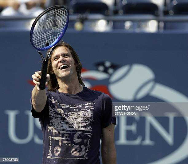Canadian actor Jim Carrey points to fans before he hit balls into the stands during an intermission 09 September 2006 between the men's semifinal...