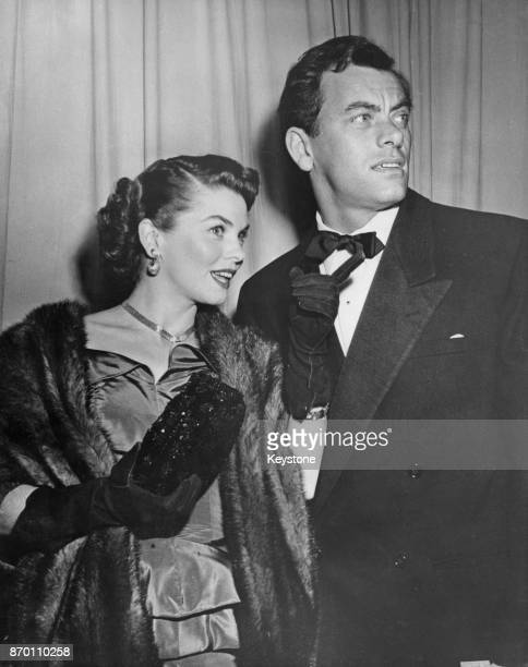 Canadian actor John Ireland and his wife actress Joanne Dru at a Hollywood premiere USA circa 1950