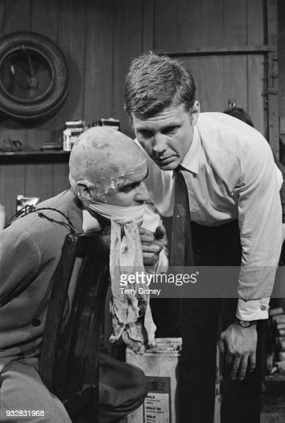 Canadian actor John Sterland has his hair shaved by British actor James Fox on the set of British crime drama film 'Performance' UK 28th August 1968