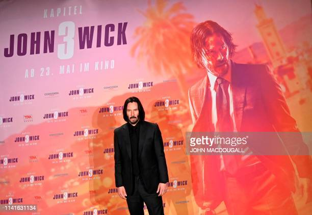 Canadian actor Keanu Reeves poses during a photocall to promote the film John Wick Chapter 3 Parabellum on May 6 2019 in Berlin