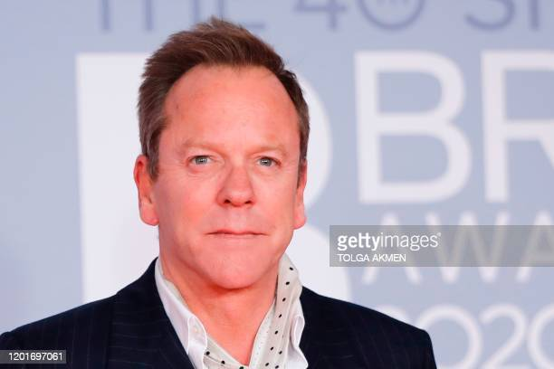 Canadian actor Kiefer Sutherland poses on the red carpet on arrival for the BRIT Awards 2020 in London on February 18 2020 / RESTRICTED TO EDITORIAL...