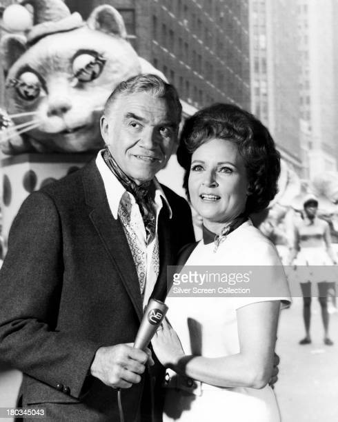 Canadian actor Lorne Greene and American actress Betty White posing for a publicity still in front of a back projection of a Macy's Thanksgiving...