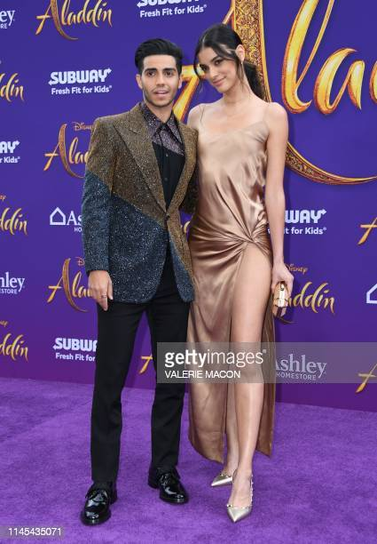 Canadian actor Mena Massoud and actress Laysla De Oliveira attend the World Premiere of Disneys Aladdin at El Capitan theatre on May 21 2019 in...