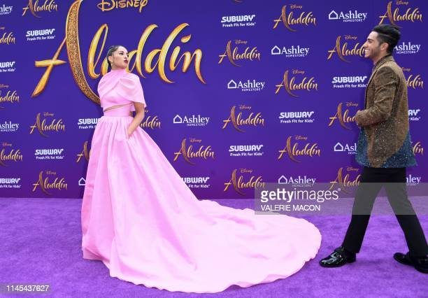 Canadian actor Mena Massoud and British actress Naomi Scott attend the World Premiere of Disneys Aladdin at El Capitan theatre on May 21 2019 in...