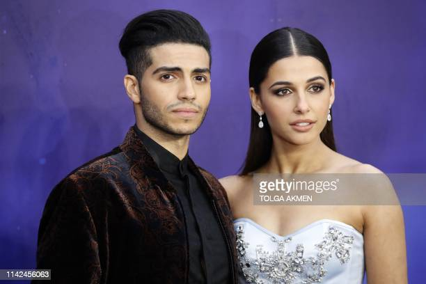 Canadian actor Mena Massoud and British actress Naomi Scott pose on arrival for the European Gala of Aladdin in central London on May 9 2019