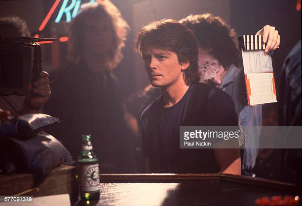 Canadian actor Michael J Fox on set at the Thirsty Whale bar during filming of the movie 'Light of Day' Chicago Illinois April 7 1986